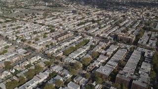 AX88_035 - 4K stock footage aerial video of neighborhoods with row houses, Brooklyn, New York