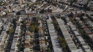 AX88_036 - 4K aerial stock footage video of flying over neighborhoods and tilting to row houses, Brooklyn, New York