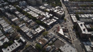 AX88_037 - 4K stock footage aerial video tilt from row houses to wider view of neighborhoods and apartment buildings, Brooklyn, New York