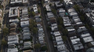 AX88_038 - 4K stock footage aerial video of following railroad tracks through urban neighborhood in Brooklyn, New York