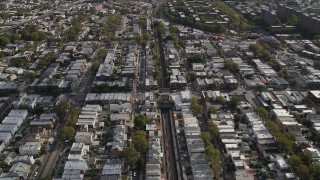 AX88_040 - 4K stock footage aerial video of following railroad tracks and flying over urban neighborhoods, Brooklyn, New York