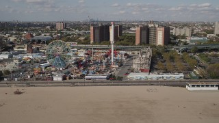 AX88_047 - 4K stock footage aerial video flyby a roller coaster and Ferris wheel at Luna Park, Coney Island, Brooklyn, New York