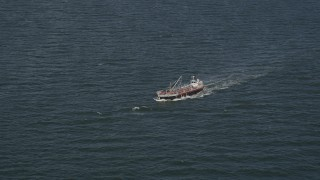 AX88_053 - 4K stock footage aerial video of tracking small oil tanker in the Atlantic Ocean