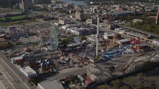 AX88_056 - 4K stock footage aerial video of flying by Luna Park rides in Coney Island, Brooklyn, New York, New York