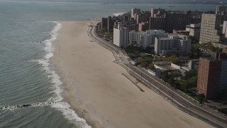 AX88_062 - 4K stock footage aerial video of flying by Coney Island Beach and boardwalk in Brooklyn, New York