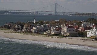 AX88_068 - 4K stock footage aerial video of flying by up0scale beachfront homes in Coney Island, Brooklyn, New York, New York