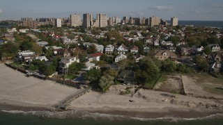 AX88_072 - 4K stock footage aerial video of flying by homes near the beach in Coney Island, Brooklyn, New York, New York