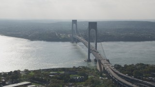 AX88_079 - 4K stock footage aerial video flyby the Verrazano-Narrows Bridge and The Narrows, seen from Brooklyn, New York