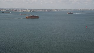 AX88_090 - 4K stock footage aerial video of two Staten Island Ferries sailing New York Harbor, New York, New York