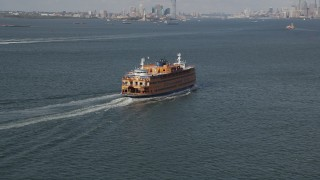 AX88_093 - 4K stock footage aerial video of flying around a Staten Island Ferry sailing New York Harbor, New York, New York