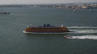 AX88_095 - 4K stock footage aerial video track a Staten Island Ferry sailing New York Harbor, New York, New York