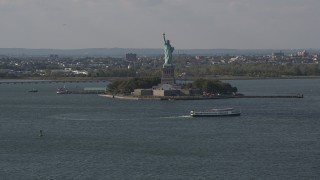 AX88_101 - 4K stock footage aerial video of flying by the front of the Statue of Liberty, New York, New York