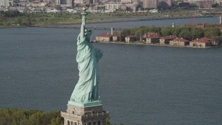 AX88_109 - 4K stock footage aerial video of the Statue of Liberty, revealing Ellis Island, New York, New York