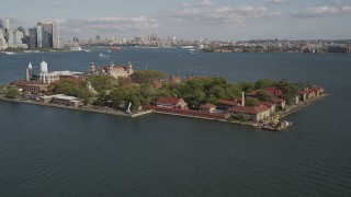 AX88_112 - 4K stock footage aerial video of flying by historic Ellis Island, New York, New York