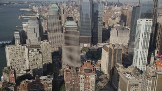 AX88_117 - 4K stock footage aerial video of flying by World Trade Center Memorial and skyscrapers in Lower Manhattan, New York