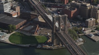 AX88_122 - 4K stock footage aerial video of flying by the historic Brooklyn Bridge, New York, New York