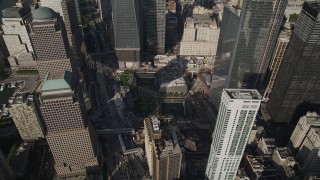 AX88_133 - 4K stock footage aerial video flyby skyscrapers and World Trade Center Memorial in Lower Manhattan, New York