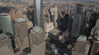 AX88_134 - 4K stock footage aerial video tilt down One World Trade Center, reveal World Trade Center Memorial, New York