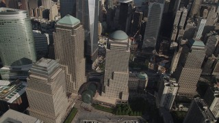 AX88_135 - 4K stock footage aerial video of flying by skyscrapers by the World Trade Center Memorial, Lower Manhattan, New York