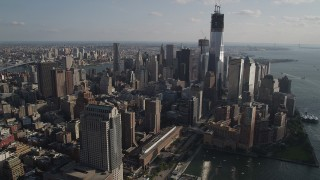 AX88_136 - 4K stock footage aerial video flyby Freedom Tower and World Trade Center skyscrapers, Lower Manhattan, New York