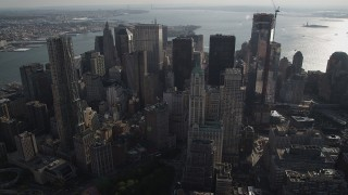 AX88_139 - 4K stock footage aerial video of flying by Woolworth Building and 8 Spruce Street skyscrapers, Lower Manhattan, New York