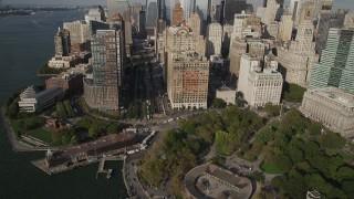 AX88_147 - 4K stock footage aerial video tilt from Battery Park, reveal Lower Manhattan skyscrapers, New York, New York