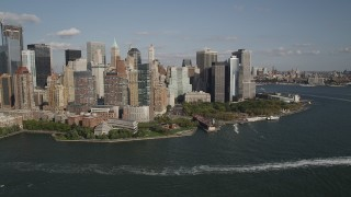 AX88_157 - 4K stock footage aerial video of flying by Battery Park and Lower Manhattan skyscrapers, New York, New York