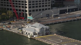 AX88_161 - 4K stock footage aerial video of the Downtown Manhattan Heliport in Lower Manhattan, New York