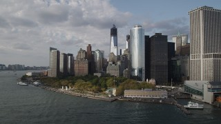 AX88_163 - 4K stock footage aerial video of Freedom Tower, seen while flying by Battery Park, Lower Manhattan, New York