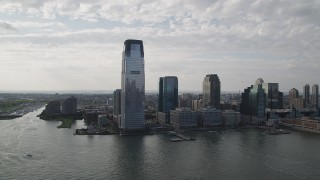 AX88_166 - 4K stock footage aerial video of approaching Goldman Sachs Tower skyscraper, Downtown Jersey City, New Jersey