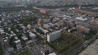 AX88_169 - 4K stock footage aerial video approach apartment buildings, row houses, Hamilton Park, Jersey City, New Jersey