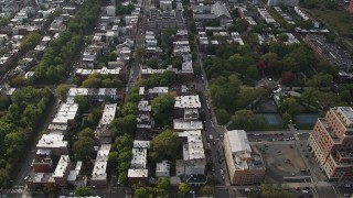 AX88_170 - 4K stock footage aerial video of flying over row houses by Hamilton Park, Jersey City, New Jersey