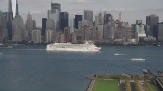 AX88_174 - 4K stock footage aerial video of a cruise ship passing Lower Manhattan skyline, New York