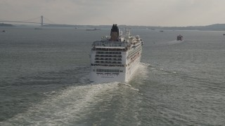 AX88_184 - 4K stock footage aerial video of flying by the stern of a cruise ship sailing New York Harbor, New York, New York