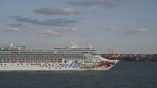 AX88_187 - 4K stock footage aerial video of tracking a cruise ship as it sails New York Harbor, New York, New York
