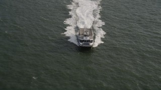 AX88_190 - 4K stock footage aerial video of tracking a ferry cruising across New York Harbor, New York