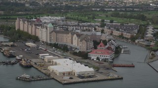 AX88_196 - 4K stock footage aerial video of flying by waterfront condominium complexes, Port Liberte, New Jersey