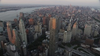 AX89_007 - 4K stock footage aerial video Flying by Lower Manhattan,8 Spruce Street, New York, New York, sunset