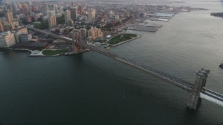AX89_009 - 4K stock footage aerial video Flying by Brooklyn Bridge, East River, New York, New York, sunset