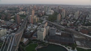 AX89_011 - 4K stock footage aerial video Flying by Brooklyn, Manhattan Bridge, New York, New York, sunset