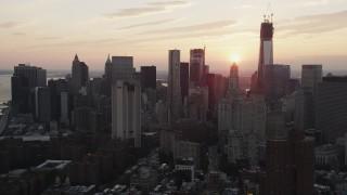 AX89_014 - 4K stock footage aerial video Flying by Lower Manhattan skyline, New York, New York, sunset