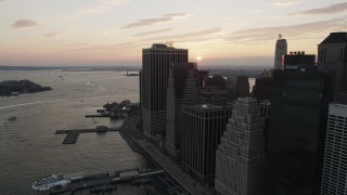 AX89_017 - 4K stock footage aerial video Flying by Lower Manhattan, Staten Island Ferry, New York, New York, sunset