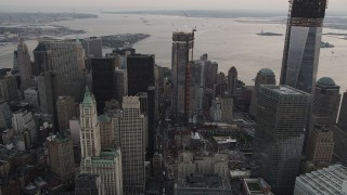 AX89_029 - 4K stock footage aerial video Flying by Four World Trade Center, Lower Manhattan, New York, New York, sunset
