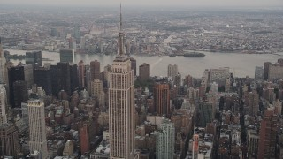 AX89_044 - 4K stock footage aerial video Approaching Empire State Building, Midtown Manhattan, New York, twilight