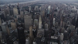 AX89_062 - 4K stock footage aerial video Approaching Chrysler Building, Midtown Manhattan, New York, twilight