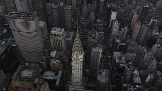 AX89_063 - 4K stock footage aerial video Bird's eye view of Chrysler Building, Midtown Manhattan, New York, twilight