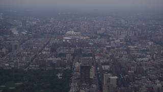 AX89_067 - 4K stock footage aerial video Flying by Yankee Stadium, Central Park, New York, New York, twilight