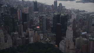 AX89_069 - 4K stock footage aerial video Flying by Columbus Circle, revealing Times Square, New York, New York, twilight