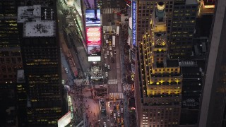 AX89_075 - 4K stock footage aerial video Bird's eye view over Times Square, Midtown Manhattan, New York, twilight