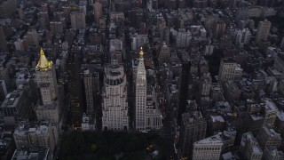 AX89_078 - 4K stock footage aerial video of Madison Square Park, Metropolitan Life North Building, Metropolitan Life Insurance Tower, New York, twilight